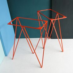 A pair of Zigzag trestle table legs powder-coated in orange. The legs are made in a fine solid steel bar, making them elegant and strong. Two fixin...
