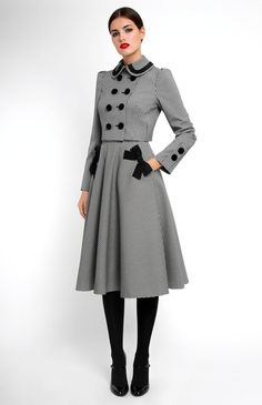 Thick stretchy cotton suit with ribbon trim. Double-breasted jacket with velvet buttons. Half circle skirt. Side seam pockets decorated with designer handmade bows. Hidden back zip closure.