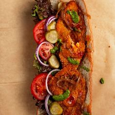 "Israeli Schnitzel Sandwich | Schnitzi Schnitzel Bar, in Brooklyn, New York, makes 9 different types of schnitzel and serves them with 13 varieties of homemade sauce. This recipe is an adaptation of its chile-flecked ""Spanish"" schnitzel. This recipe first appeared in our April 2011 special Sandwich Issue with author David Sax's article Taste of Home. From: saveur.com"