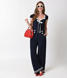 Off to a maritime adventure, darling? Fresh from Voodoo Vixen, this navy blue jumpsuit boasts a stylish sweetheart neckline with structured empire seams for a sleek and flattering fit. Topped with a bow, white piping highlights the neckline, sleeves, and
