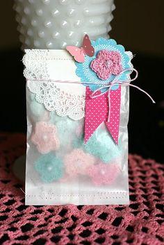 Crochet flowers in pretty packaging.: