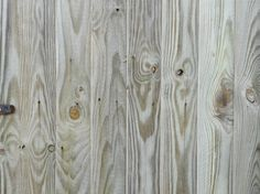 Whitewashing emphasizes the unsophisticated allure of knotty pine.
