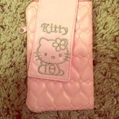 <Hello Kitty>  Pink Holder  Can possibly hold a cellphone or whatever you want! Pen mark on back of case as pictured Hello Kitty Accessories