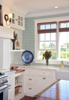 Gorgeous White Coastal Kitchen Interior Design With Sweet Nuance. Love the blue tile with white cabinets Kitchen Redo, New Kitchen, Kitchen Remodel, Kitchen Ideas, Kitchen Small, Kitchen Renovations, Kitchen Shelves, Kitchen Layout, House Of Turquoise
