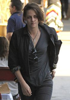 Keeping warm: Later on the same day, Kristen was spotted on her own in the same outfit, ha...