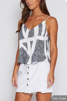 Woman fashion summer chic :We are currently obsessing over this cami. It adorned with geometrical print, sleeveless and v-neckline. Style it with skorts and mini skirts will be perfect.