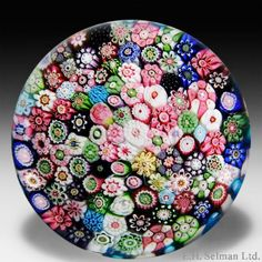 Rare antique Clichy signed close packed millefiori with roses paperweight.