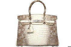 Price; $298,655 A diamond-encrusted, white gold crocodile skin handbag isn't Hermes's bread and butt... - TheStreet