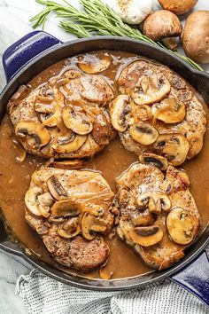 Easy Smothered Pork Chops- Smothered Pork Chops are a classic American dish that is easy to make and full of delicious flavor. Thick cut pork chops are covered in a perfect, savory gravy with onions and mushrooms. Thick Cut Pork Chops, Juicy Pork Chops, Baked Pork Chops, Easy Pork Chop Recipes, Pork Recipes, Cooking Recipes, Mushroom Pork Chops, Pork Chops With Mushrooms, Honey Garlic Pork Chops