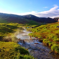 A natural hot river in Iceland. I've you like hiking or even walking you have to do this hike form the town Hveragerdi in Iceland. The beautiful mountains are dotted with stinky geothermal pools, many too hot to even touch. Finally you reach the warm waters. Worth the effort I think.