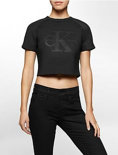 soft neoprene in a trendy cropped style featured as part of the black series limited edition.