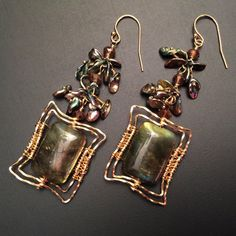 Gorgeous deep green labradorite stones are framed by spiraling 14K goldfilled wire, below leafy little green Keshi pearls, like Windows on the Forest.