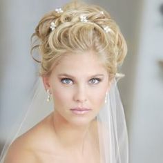 I'm definitely looking for a hairstyle that can be worn with tiara and veil.