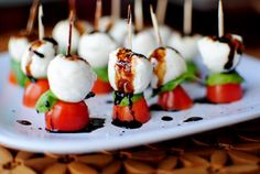 Caprese Skewers with Balsamic Drizzle are perfect bites of freshness. Enjoy this healthy appetizer recipe year round!