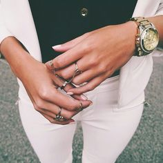 Jewelry and outfit colors.