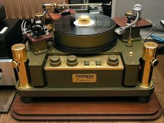 Thorens Reference Turntable, 1979.  These were available in a number of finishes.  Most were gloss white or gloss black.  The factory would use any color you specified for an additional cost.  Wonderful flexibility, multiple arms, allows one to use an arm dedicated to 'mono', and of course two for MM and MC cartridges and 9 or 12 inch tonearms..   Not a big fan of belt drive turntables, but once the 30+lbs platter gets up and spinning, it provides plenty of drive force..