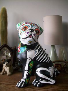 ceramic sugar skull/ tattoo/ day of the dead/ pug by pookielou on DeviantArt Halloween Painting, Doll Painting, Halloween Cat, Pugs For Sale, Mexico Tattoo, Sugar Skull Artwork, Day Of The Dead Artwork, Sugar Skull Tattoos, Sugar Skulls