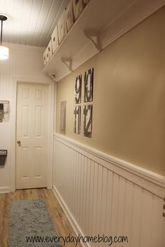 Laundry room wall. - high shelves on the opposite side of laundry room? or are doors in the way. or high up in guest bedroom.