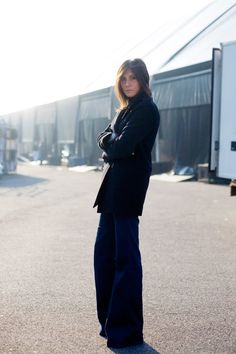Emanuelle Alt in flared denims and wool coat