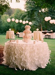 Frilly cake table, Katie....I love the table cloth!!!!!