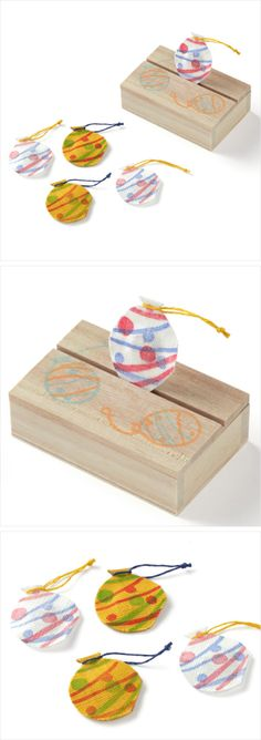 【絵形香 水風船(中川政七商店)】/屋台のヨーヨー吊りをイメージした絵形香です。手績み手織り麻でかたどった水風船を、桐箱の蓋に立てて香りを楽しむことができます。小さなお飾りとして机や棚の上にそっと置くだけで、お部屋が夏らしい雰囲気に。かばんや財布に忍ばせて、携帯用の小さな香りものとしてもお使いいただけます。お手紙に添えて、香りとともに夏を贈るのもおすすめです。 #souvenir