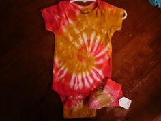 Tie Dye Red and Mustard Onesie and sock by NereidasNiftyThreads, $14.00