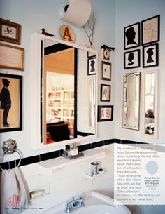 Gorgeous bathroom. Black & white decor with tons of art framed on the wall. The collection of silhouettes is gorgeous