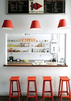 orange accents and diner style menus. this kitchen makes me gaga. and my favorite part? the little clock collection flanking the center of the top shelf. Clock collections make me soooo happy.