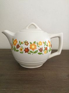 A personal favorite from my Etsy shop https://www.etsy.com/listing/280941594/mccoy-usa-ceramic-teapot-140-mccoy