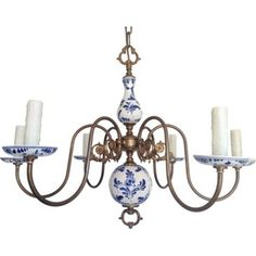 Another blue delft chandelier lighting pinterest delft six arm blue and white delft style porcelain chandelier featuring antique brass scrolled arms embellished with medallions and floral bobeches mozeypictures Choice Image