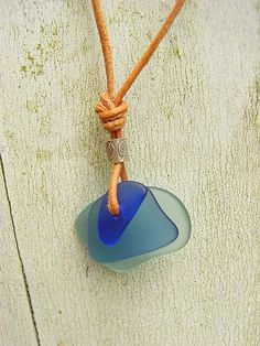 Blue Sea Glass Pendant with Sterling Silver Bead on Leather Cord