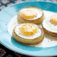 Eggs cooked in rings of onion.
