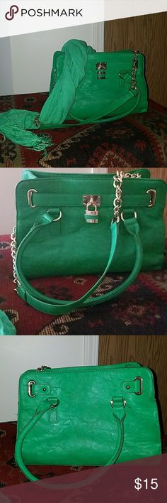 Pretty green purse with matching scarf Have a nice green purse with matching scarf.  Both have been gently used a couple of times.  Im not sure the brand of the purse.  Has a C emblem on the inside zipper pocket, but no other markings.  Has 3 handles, 2 smaller to carry on your arm and 1 longer handle with gold chains on each side, for wearing over your shoulder.  Scarf is Apt 9 brand, but i did unstitch the tag to remove it as i dont like the tags on my scarfs.  Both match perfectly to wear…