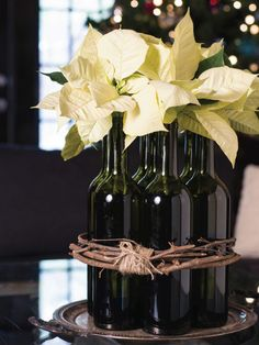 Poinsettia Decor with wine bottles tied either with twine or grapevine