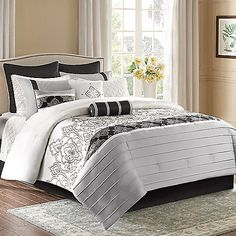 Bring beauty to your bedroom with the exquisite Madison Park Temsia 12-Piece Comforter Set. Dressed in black damask embroidery on an off-white charmeuse fabrication and finished with grey pleating, the bedding adds a lavish look to any room's décor.