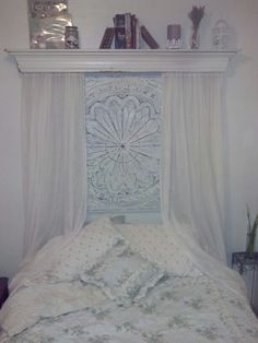 My diy  shabby chic bed! Fireplace crown $20 bucks at flea market. Tin wall hanging painted blue then white. Sanded to reveal metal. $17.99 @ ross. New headboard for under $40 !