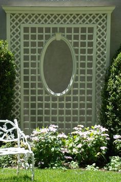 unsightly residential wall was turned into a decorative focal point with a decorative trellis work Porch Trellis, Trellis Gate, Garden Trellis, Garden Gates, Wood Trellis, Herbs Garden, Fruit Garden, Front Porch Landscape, Fence Landscaping