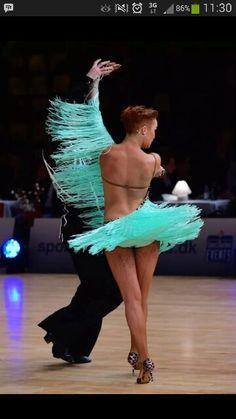 Turquoise fringe emphasizes Latin dance movements----