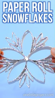 These paper roll snowflakes are SO BEAUTIFUL and really easy to make! This is such a great Christmas craft that you can leave up all winter long. Hang them on the Christmas tree, or in the window as a Christmas Crafts To Make, Diy Christmas Ornaments, Christmas Projects, Simple Christmas, Kids Christmas, Handmade Christmas, Holiday Crafts, Recycled Christmas Decorations, Christmas Toilet Paper