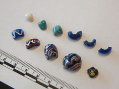 Beads from the Ribe Posthuset Excavation 725-760. These beads were made at a seasonal craftworkers' campground in western Denmark. The blue beads decorated with red, white & sometimes yellow were made primarily in Ribe & later at Åhus. They occasionally spread to elite sites northward into Sweden but with very few found on Gotland. Even as western craftsmen & merchants were increasingly sailing into the Baltic, Gotlanders must have been seeking other trade routes.(Sydvestjyske museer, Ribe…