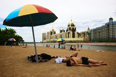 Astana, Kazkhstan  The nearest sea or ocean is several thousand kilometers away in any direction, so the nearest thing there is in the torrid Astana summers are the beaches of the river that passes through the city. Happy sunbathing.