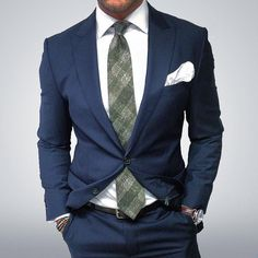 Moss plaid tie, navy suit and white pocket square.