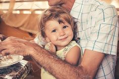 Child with father have a breakfast. by travel_maker on