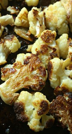 Roasted Cauliflower with onions and garlic and topped off with Parmesan cheese. The caramelized vegetables make a delicious side dish.