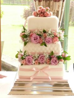 This 3 layer square cake is so beautiful that you wouldn't want anybody to spoil its beauty.