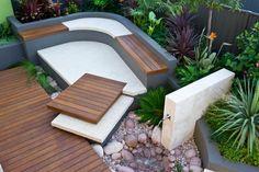 Eck-Sitzbank aus Beton und Holz bauen und Springbrunnen daneben