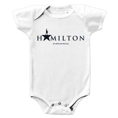 This onesie features the Hamilton An American Musical title artwork on the front and #gothamilton on the back.