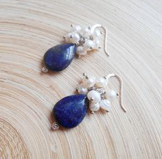 A lovely and timeless pair of earrings that features navy blue lapis lazuli smooth almond briolettes adorned by a rich cluster of lustrous white freshwater pearls, meticulously wire wrapped with sterling silver ball head pins. ▪️Total height (including earwires): 4,00 cm (1.57