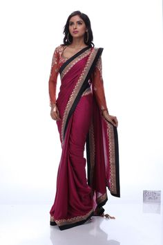 Enticing  pink saree epitomizes grace and simplicity. The contrasting wide border with black and antique silk patti is an absolute admixture of tradition and contemporary style. Grab eyeballs at any event with this alluring drape.