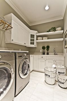 Gorgeous white on gray laundry room - clean and crisp